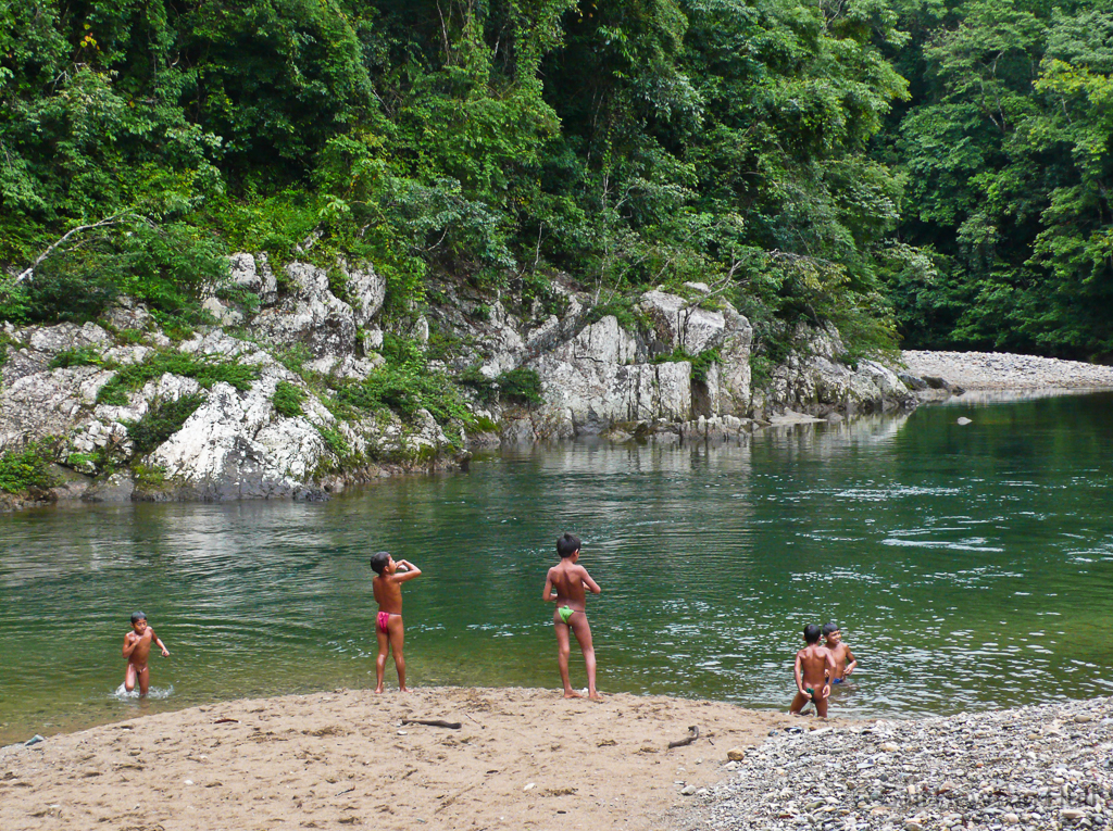 Boys play along the Chagres River in the 320,000 acre Chagres National Park